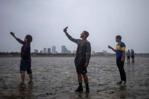'O mar secou': por que a água se retrai antes da chegada de um furacão