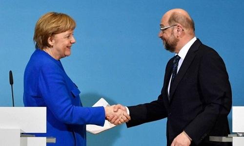 Merkel e Schulz confirmam pré-acordo para grande coalizão na Alemanha