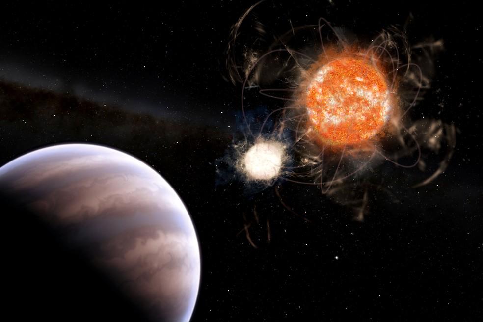 Planeta gigante e duas estrelas anãs.