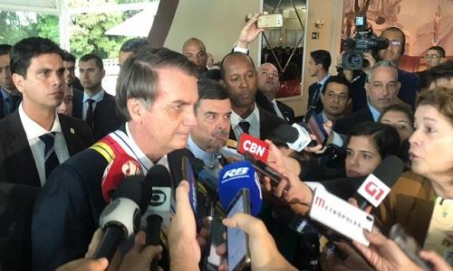 Bolsonaro : 'Página virada', sobre crise com Rodrigo Maia