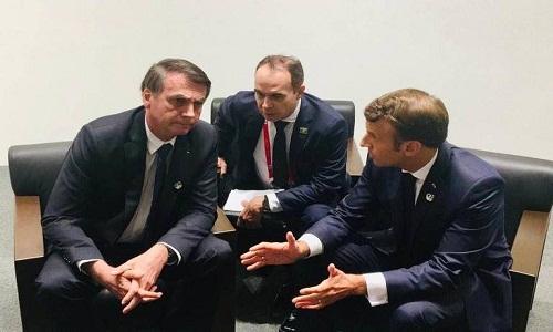 Bolsonaro encontra Macron e o convida a visitar Amazônia